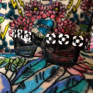Black frame floral embellished Prada sunglasses